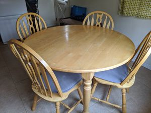 Round to oval kitchen table and chairs... Solid wood. Heavy & sturdy! for Sale in Glendora, CA