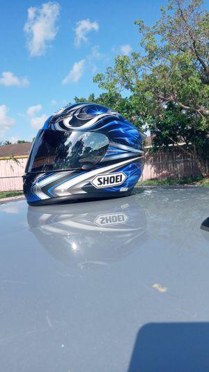 Size large shoei helmet not a single scratch beautiful looking helmet for Sale in Miami, FL