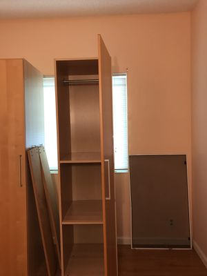 Closet with shelves and hanger clothes for Sale in Newark, CA