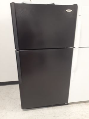 Whirlpool top freezer refrigerator used in good condition with 90 day's warranty for Sale in Mount Rainier, MD