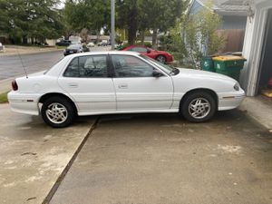 2001 Pontiac Grand Am 70,000 miles runs great smogged perfect condition gas saver for Sale in Sacramento, CA
