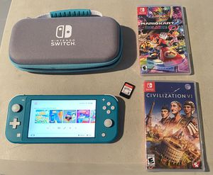 Nintendo Switch Lite Turquoise with case and 3 games for Sale in Miami, FL