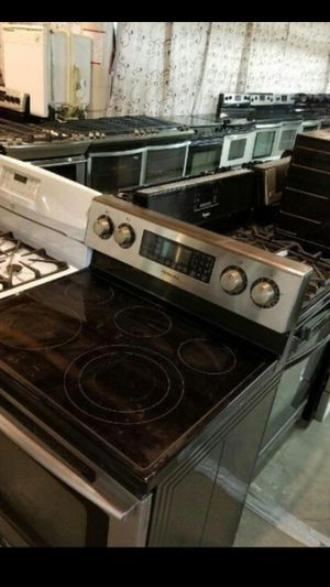 **Huge Sale store full of nice reconditioned refrigerator washer dryer stove stackable+financing available a free warranty for Sale in Des Moines, WA