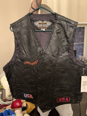 Men's Genuine Leather Motorcycle Vest w/patches for Sale in Denton, TX