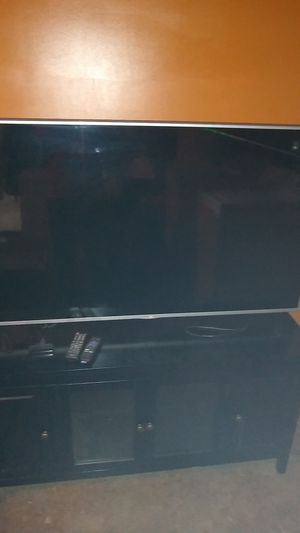 LG 55inch and Roku and stand} for Sale in Dothan, AL
