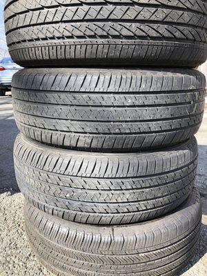 Set 4 used tire 235/60R18 three BRIDGESTONE end one MICHELIN set 4 used tire $180 4 llantas usadas 235/60R18 3 BRIDGESTONE y una MICHELIN por las 4 l for Sale in Alexandria, VA