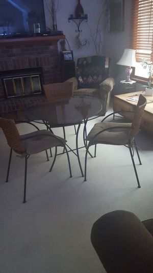 Pier one table with three matching chairs for Sale in Traverse City, MI