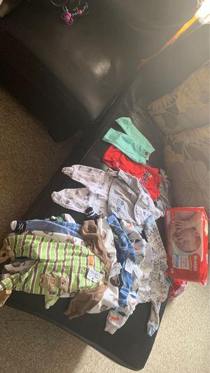 1 package of diaper newborn, 7 sleepwear, 1 pijama newborn, 2 bodysuits and 1 newborn pants for Sale in Central Falls, RI