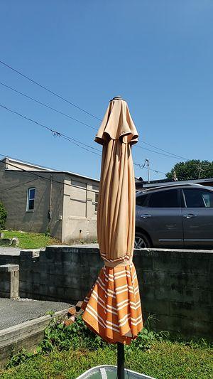 Orange 🍊 table umbrella for Sale in Columbia, PA