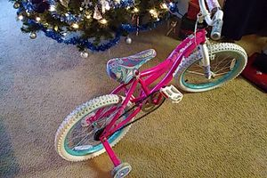 Girls bike with training wheels for Sale in Baltimore, MD