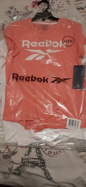 Pink and white Reebok shirts for Sale in Lithia Springs, GA