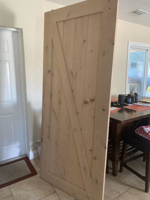 Solid wood barn door with installation kit included . 3feet wide by 6 feet long for Sale in St. Petersburg, FL