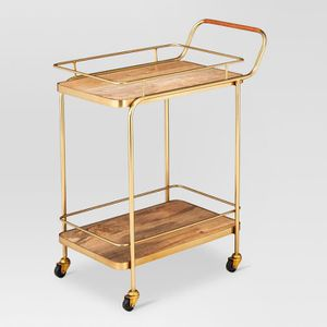 Metal, Wood, and Leather Bar Cart - Gold - Threshold™ Attractive gold metal frame Wood shelves for sturdy storage Convenient casters allow for easy for Sale in Monrovia, CA