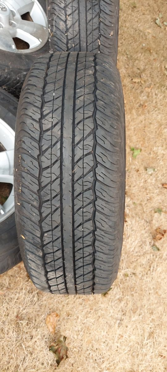 4 brand new Dunlop tires and rims
