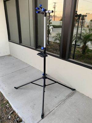 New adjustable 41 to 75 inch bicycle bike repair stand with handlebar stabilizer bar 66lbs capacity excellent quality for Sale in Whittier, CA