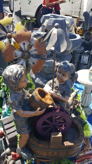 Water fountain with spinning wheel and spinning umbrella for Sale in Vernon, CA