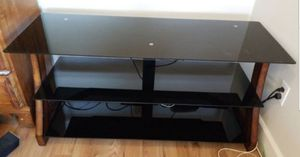 Black glass 3 tier tv stand 50 inches long/16.5 inches deep/24 inches tall for Sale in Jurupa Valley, CA