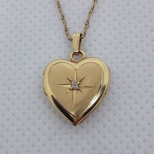 Real Solid 10K Gold Opening Heart Picture Charm with Real Diamond and Real Solid 10K Gold Necklace for Sale in Hallandale Beach, FL