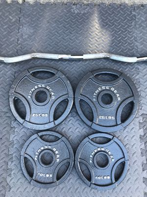 Olympic Curl Bar and 70 lbs Weight Plates for Sale in Alpharetta, GA