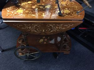Antique table with wheels for Sale in El Cajon, CA