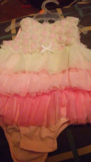 Onezzie like pink and cream fasssen between the legs dress for lil girl 6 to 9 month very pretty for Sale in Clanton, AL