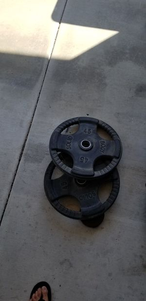 Weight plates. Pair 45 pounds body solid rubber weight plates for Sale in San Diego, CA