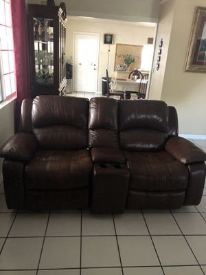 Brown leather couch that is reclining for Sale in Riverside, CA