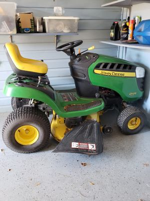 John Deere riding mower D105 with leaf bag and wagon for Sale in Bastrop, LA