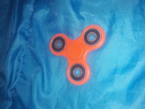 Orange fidget spinner for Sale in Stevens Point, WI