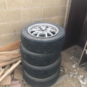 Set Of (4) With The Rim P205/60R16 for Sale in Las Vegas, NV