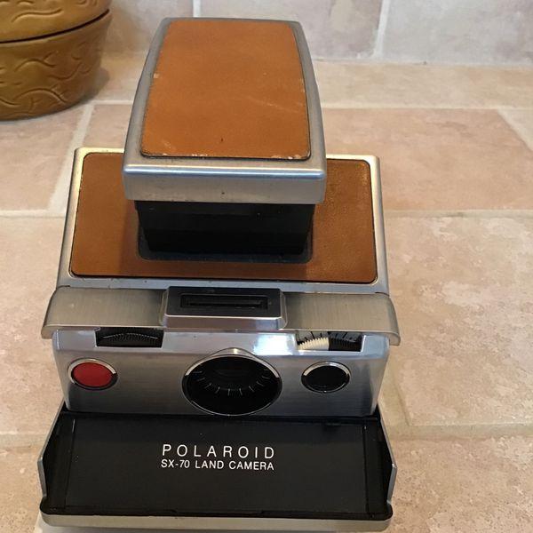 Polaroid Sx-70 Land Camera And Film