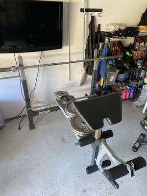 Marcy Olympic bench w/Olympic bar & weights. for Sale in Tampa, FL