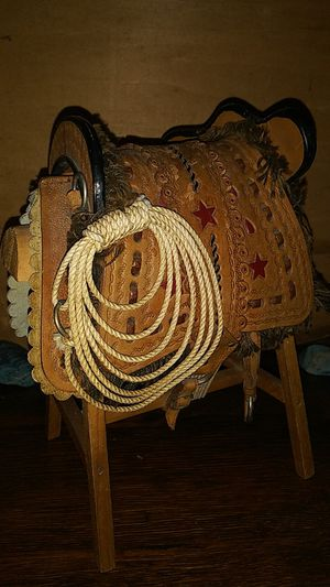 Saddle doll 9 inch leather lasso on wood stand for Sale in Clarksville, TN