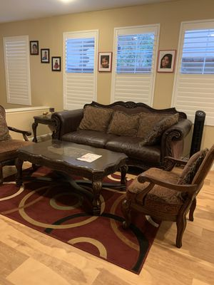 Ashley sofa plus 2 chairs and coffee table for sale for Sale in Irvine, CA