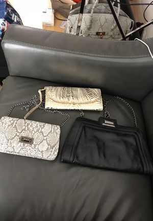 Gently used clutch purses crossbody wristlet gold black snake for Sale in San Francisco, CA