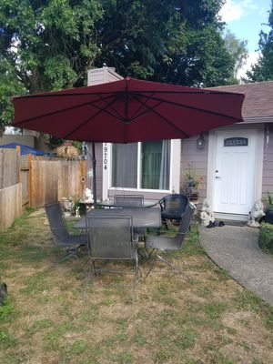 6 piece iron patio set one table 4 rocking chair and big umbrella for Sale in Tualatin, OR