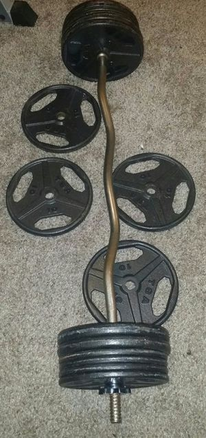 Weights metal 120lbs. 8x10lbs, 8x5lbs and curl bar with 2 weight lock clips. for Sale in Deerfield Beach, FL