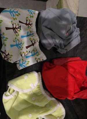 4 diaper covers plus 10 other diapers for Sale in Roselle, IL