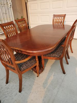 7 piece All Wood Dining table with 6 chairs for Sale in Montclair, CA
