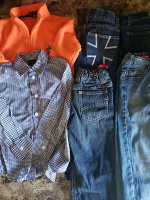 Size 5 kids winter clothes $10: 4 pairs of Jean's, a sweatshirt and a button up long sleeve! for Sale in Clovis, CA