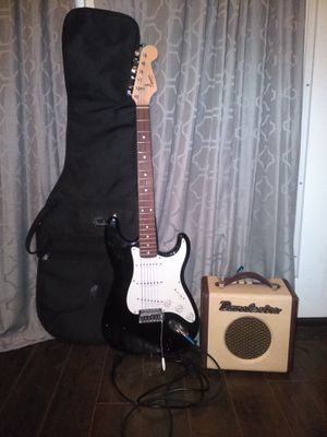 Squier Bullet Strat by Fender Gituar with Soft Black Guitar Cover a Danelectro Amplifier and a mic stand. for Sale in Houston, TX