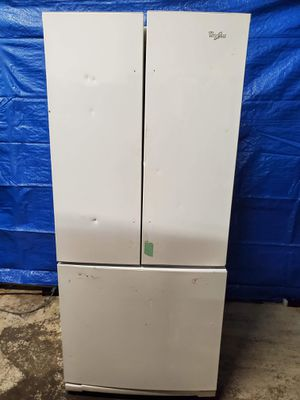 Fridge good working conditions missing handles but fridge and freezer working good $49 for Sale in Denver, CO
