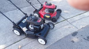 HONDA LAWN MOWER THE BLACK IS SELFPROLLED AND THE RED IS PUSH MOWER BOTH ARE WORKING GOOD FOR 120 $ FOR BOTH for Sale in Tacoma, WA