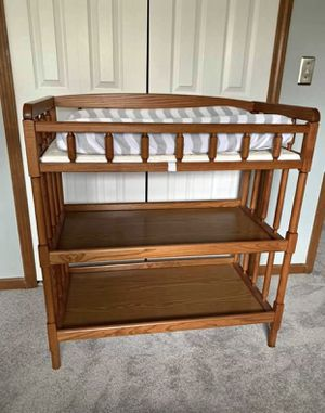 All wood changing table with pad for Sale in Farmington Hills, MI