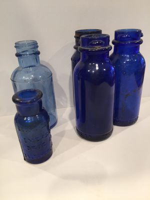 Antique blue glass medicine apothecary bottles for Sale in Wake Forest, NC