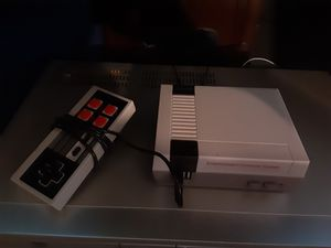 Mini Nintendo with 2 controls n Games for Sale in Las Vegas, NV