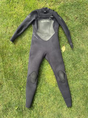 Excel 3/4 women's wetsuit size 12 with quicksilver booties for Sale in Seattle, WA