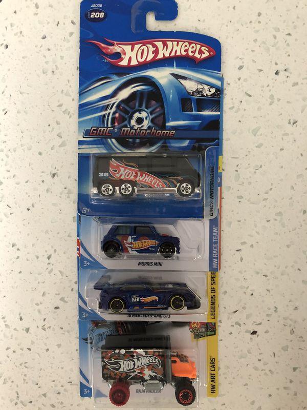 Set of 4 Hot Wheels branded cars Mercedes-Benz, GMC Motorhome, Morris Mini, Baja Hauler