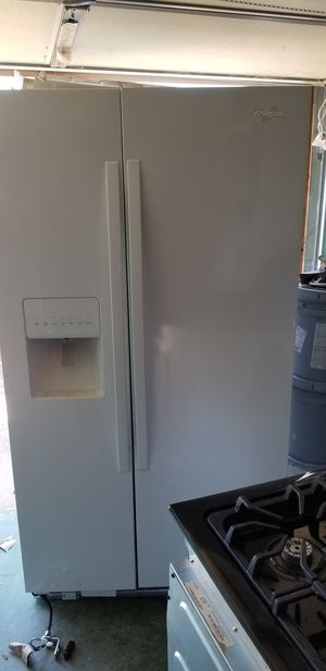 Set of white Whirlpool appliances with a kitchen dishwasher for Sale in Philadelphia, PA