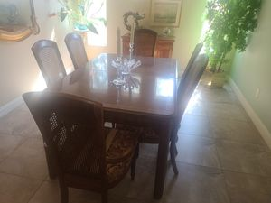 Dining set with 6 chairs 3 leaves and pads for the table for Sale in North Las Vegas, NV